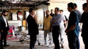 Türkmenoğlu, yangında hasar gören iş yerlerini ziyaret etti
