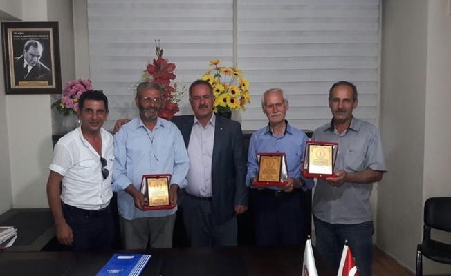 Erciş'te mesleğinde 40 yılını doldurmuş 4 ustaya plaket