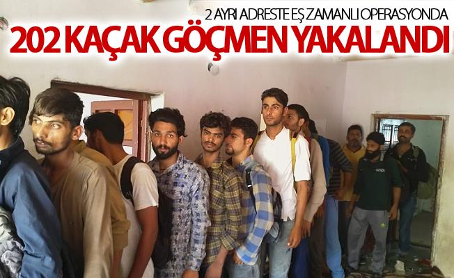 2 ayrı adreste eş zamanlı operasyonda 202 kaçak göçmen yakalandı
